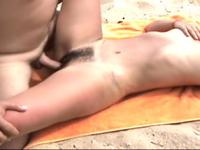 Horny slut sucking cock on the beach
