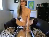 Cute looking nerdy babe sucking on her toys