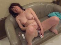 Japanese MILF masturbating with her toys on the sofa