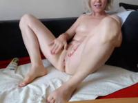 Old women masturbates in front of the camera