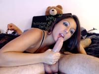 Brunette gives a blow job to a guy