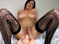 Big ass woman sits on a dildo