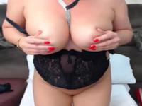 Milf plays with her big tits