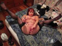 Redhead is playing with herself
