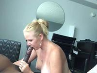 A blonde licks a black cock