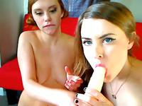 Two girls play with a dildo