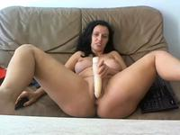 Brunette is massaging her pussy