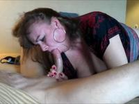 Brunette is licking a hard cock