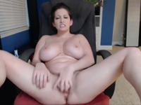 A hot slut is licking her tit