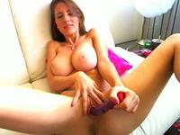 Busty gorgeous webcam princess in action
