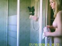 Cute blonde taking a shower