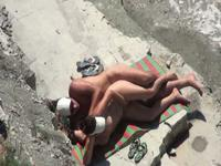 Nudist couple caught on the beach