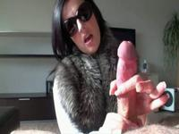 Babe with sunglasses handling a dick