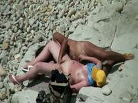 Interracial fuck action on the beach