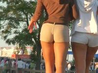 Tight shorts girls are walking in front of me deliciously waving the incredible butts