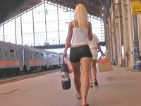 The beautiful long haired blonde in tight booty shorts was recorded on railway station