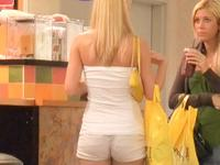 Long haired blonde chick in tight white shorts was recorded on voyeur cam from behind